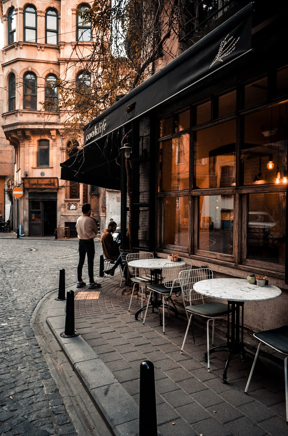 a cafe outside next to the street