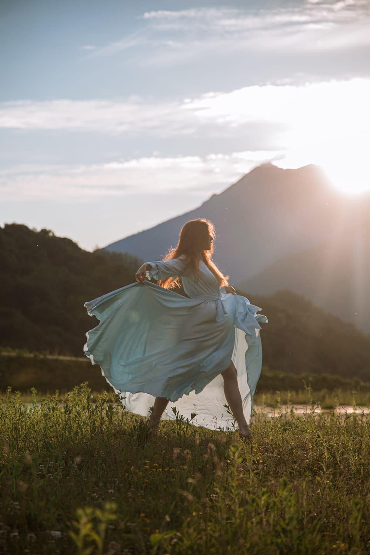 a woman dancing on a field