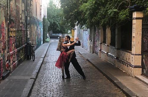man and woman dancing tango in the street