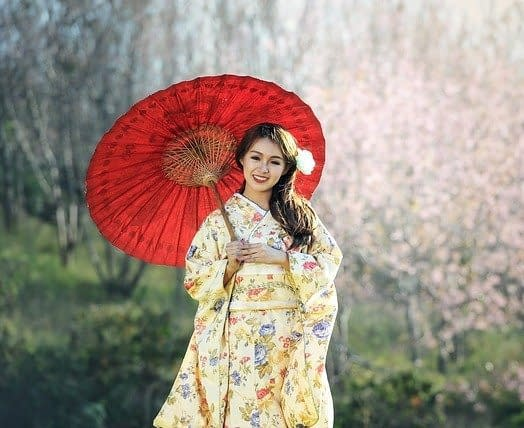 woman in japanese dress with a red umbrella