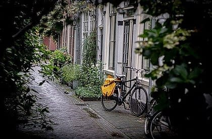 post bicycle standing in front of a house in Zutphen