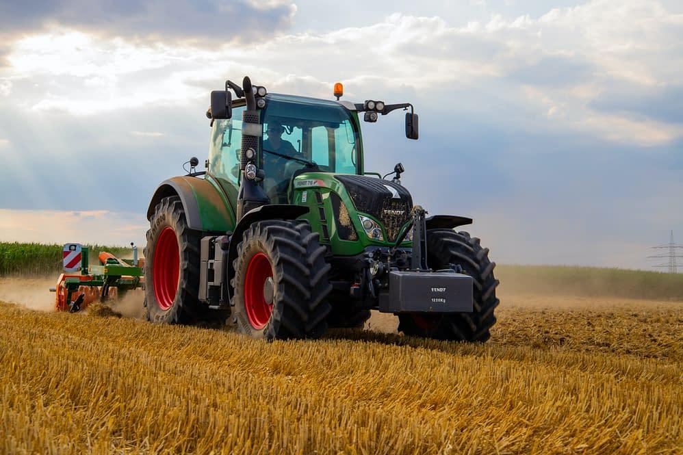 a farmer on a harvest machine