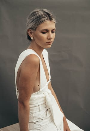 young woman dressed in a white dress with grey hair