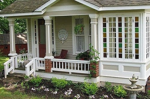 white tiny house with veranda