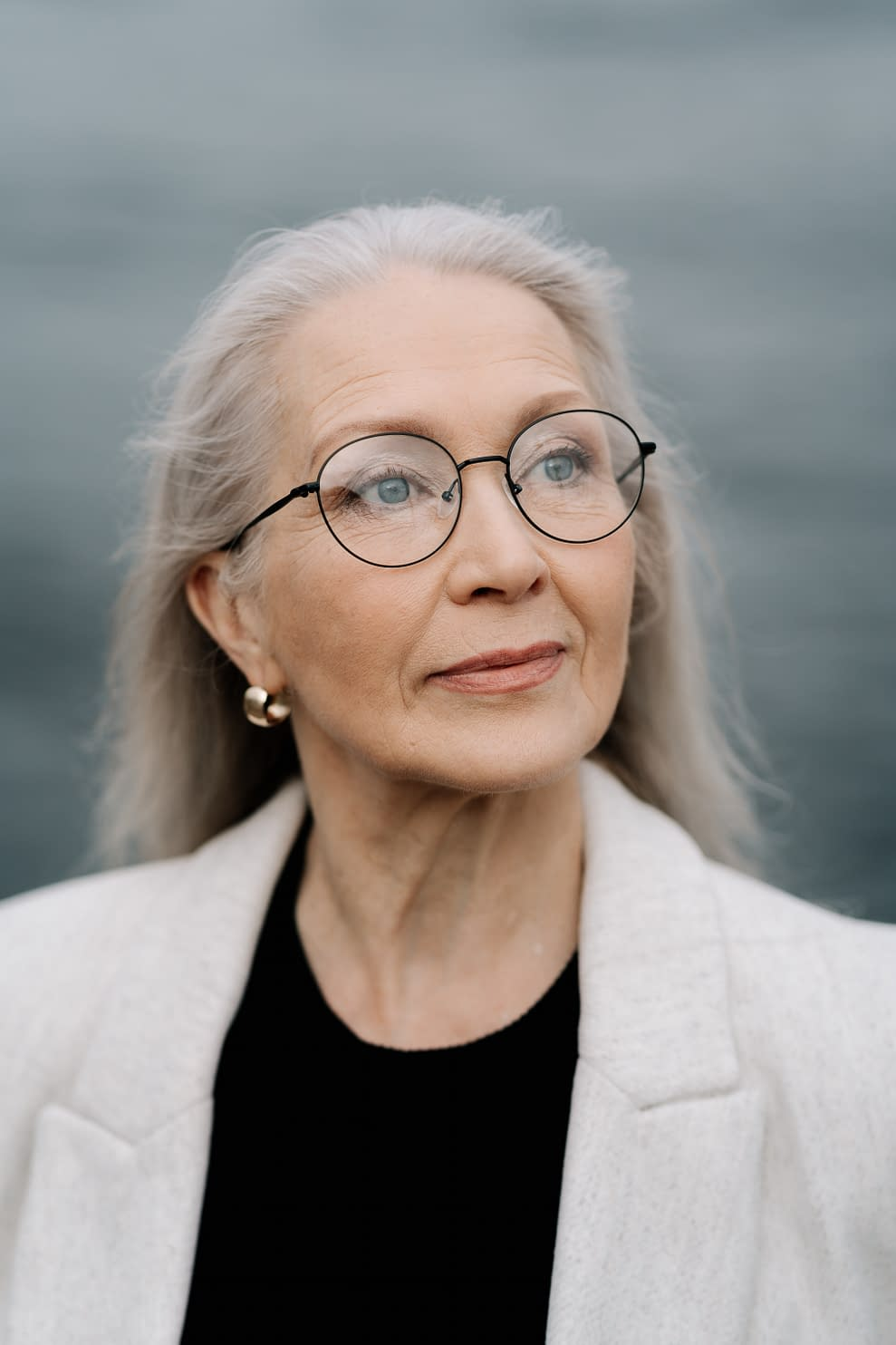 older woman, grey hair with glasses