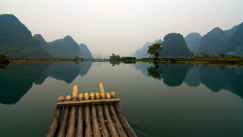 a peaceful scenery, with a calm water, forest and a lake, zen atmosphere