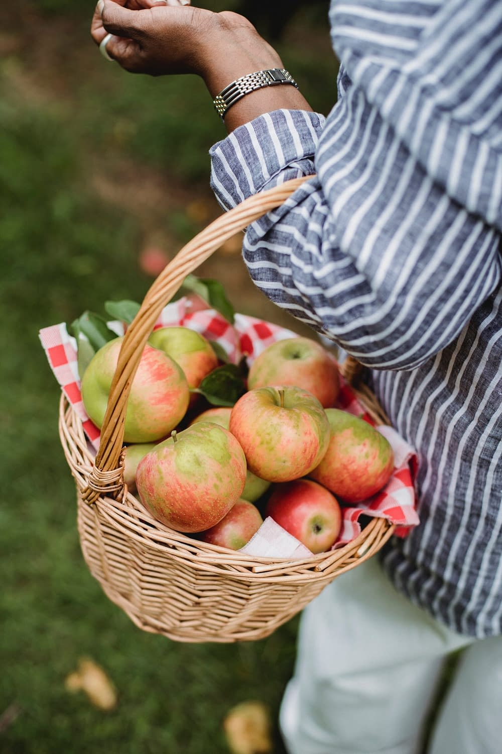 a woman carrying apples