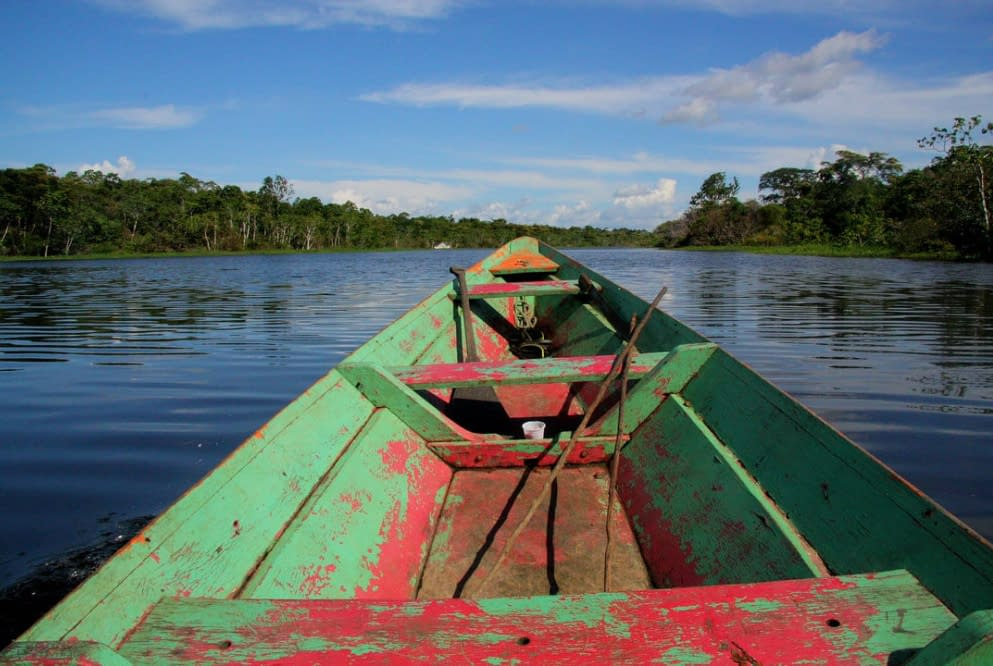 a boat floating over the Amazon river