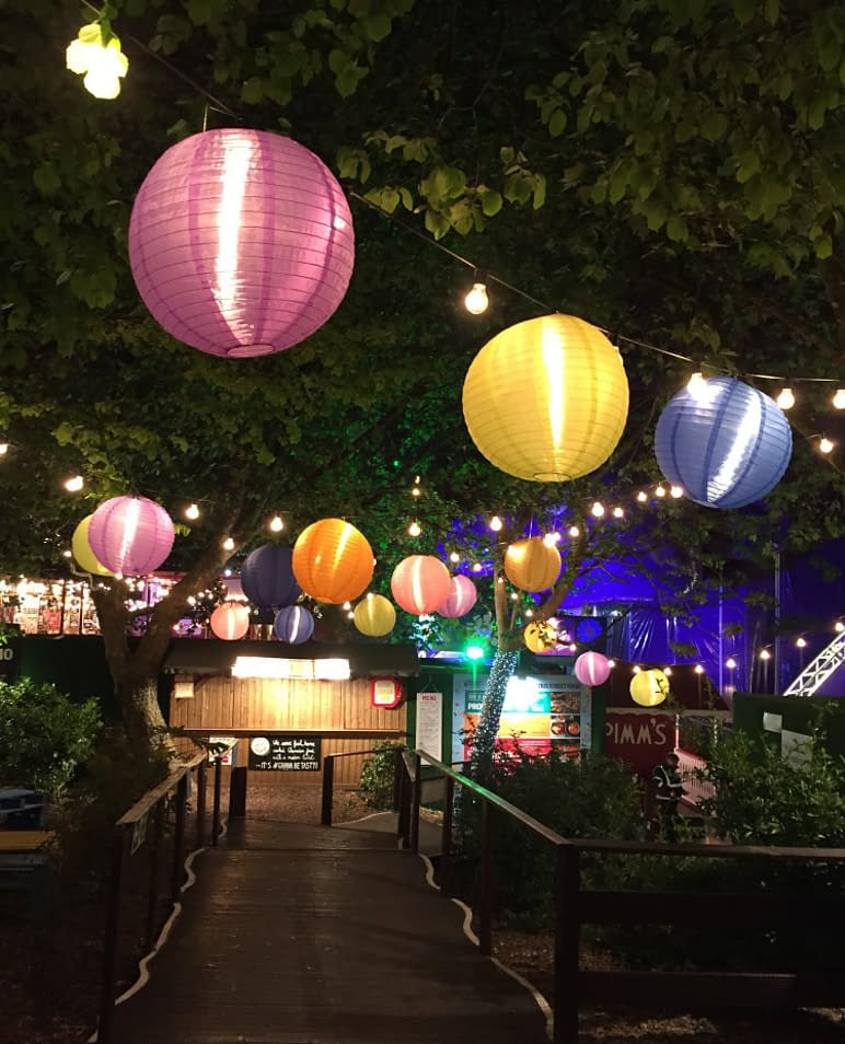 Hanging ball lamps in a garden at night
